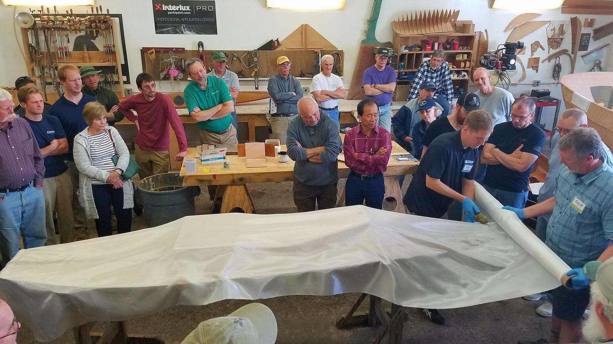 John and Geoff demonstrate fiberglassing