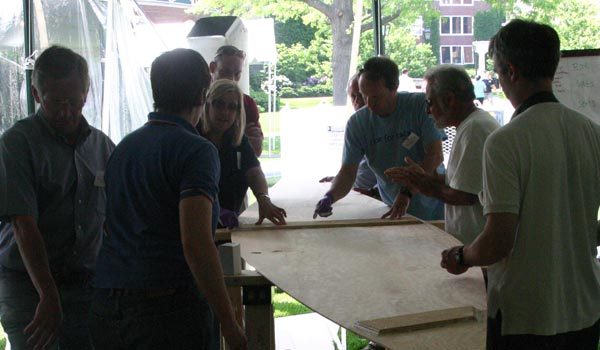 harvard, business school, corporate event, teambuilding, build boat, wooden boat, chesapeake light craft, peace canoe, boatbuilding