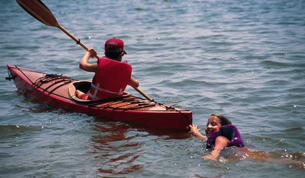 rockhall, clc demo, chesapeake light craft, wooden kayak, wooden boat, child paddling