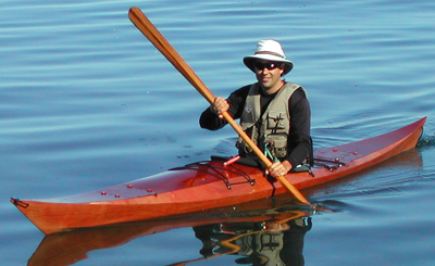 Eric Schade in a Shearwater 17 with a Greenland Paddle